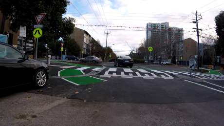 Bicyclists are not clearly directed to onto the green strip
